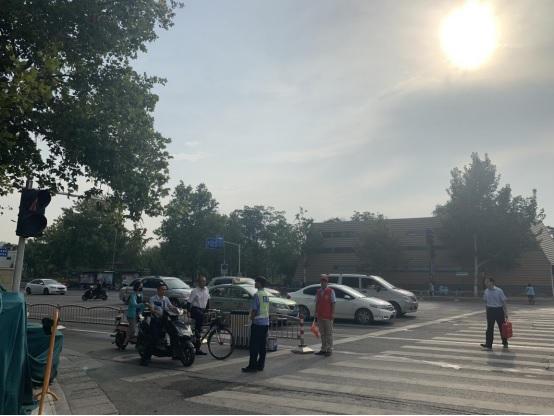 迎民族盛会 庆七十华诞:邮储银行郑州市分行积极开展文明交通志愿服务活动